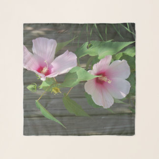 two pink hibiscus flowers on a scarf