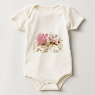 Two pink piggy banks on spread euro notes baby bodysuit