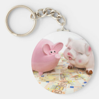 Two pink piggy banks on spread euro notes basic round button keychain