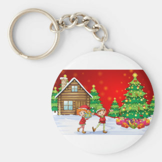 Two playful dwarves near the christmas trees basic round button keychain