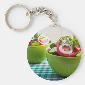 Two portions of useful vegetarian meal basic round button keychain