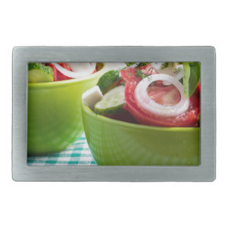 Two portions of useful vegetarian meal belt buckle