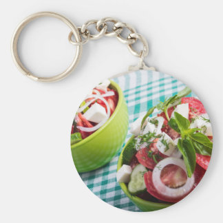 Two portions of useful vegetarian meal closeup basic round button keychain