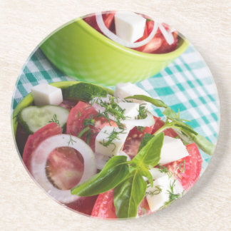 Two portions of useful vegetarian meal closeup beverage coaster
