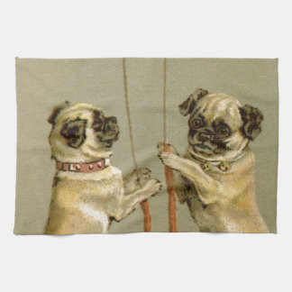 Two pug dogs ringing the Christmas bells Kitchen Towels