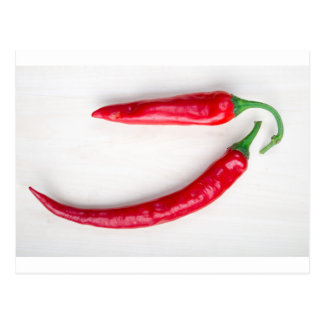 Two red hot chili pepper closeup postcard