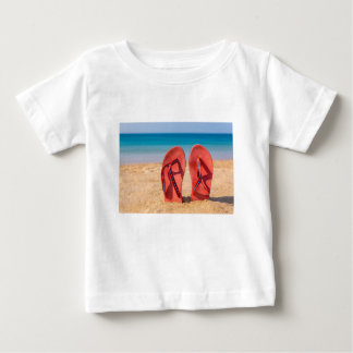 Two red slippers upright in sand of beach.JPG Baby T-Shirt