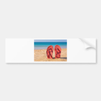 Two red slippers upright in sand of beach.JPG Bumper Sticker