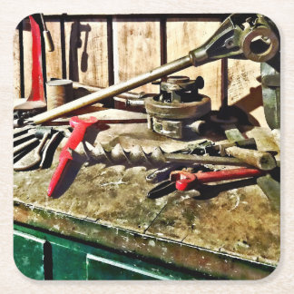 Two Red Wrenches on Plumber's Workbench Square Paper Coaster