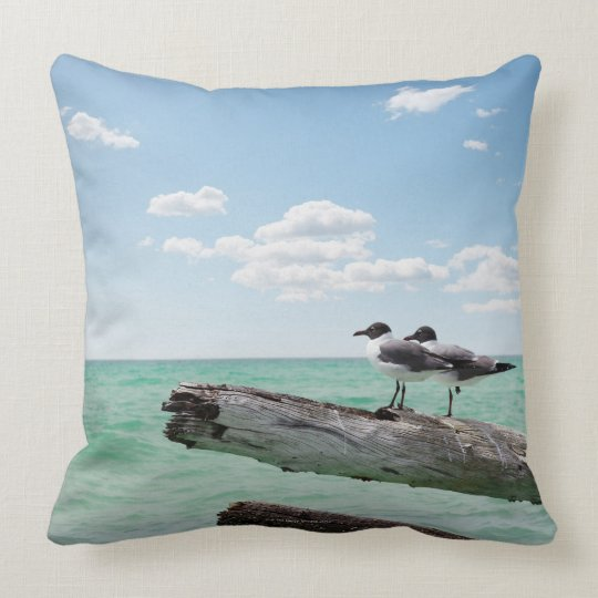 Two seagulls sitting on a dead tree sticking out throw pillow