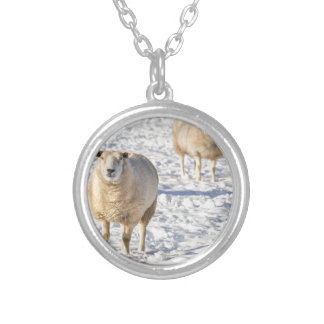 Two sheep standing in snow during winter silver plated necklace