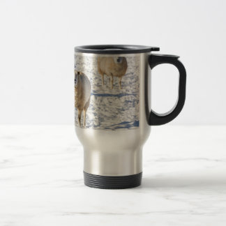 Two sheep standing in snow during winter travel mug