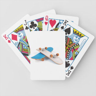 Two skateboards bicycle playing cards