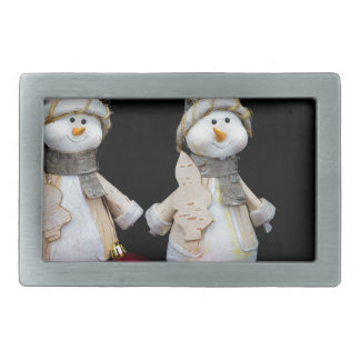 Two snowmen figurines with red baubles on black belt buckle