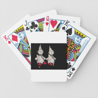 Two snowmen figurines with red baubles on black bicycle playing cards