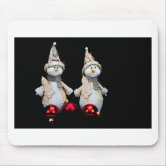 Two snowmen figurines with red baubles on black mouse pad