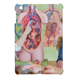 Two students learning model human body in biology. cover for the iPad mini