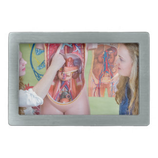 Two students learning model human body in biology. rectangular belt buckle