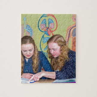 Two students learning with books in biology lesson jigsaw puzzle