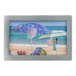 Two sun umbrellas and beach supplies at sea.JPG Belt Buckle