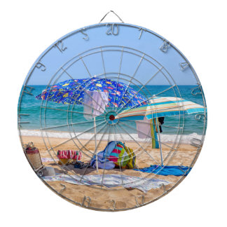Two sun umbrellas and beach supplies at sea.JPG Dartboard