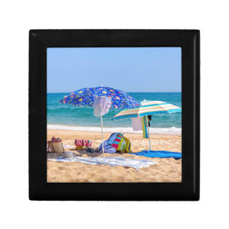 Two sun umbrellas and beach supplies at sea.JPG Gift Box