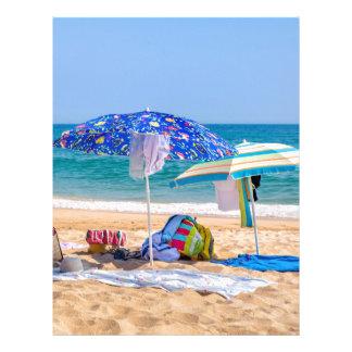 Two sun umbrellas and beach supplies at sea.JPG Letterhead