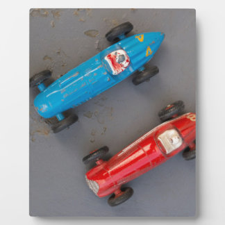 Two toy vintage cars plaque