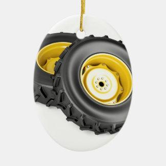 Two tractor wheels ceramic ornament