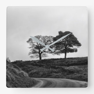 Two trees in black and white square wall clock