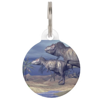 Two tyrannosaurus dinosaurs pet tag