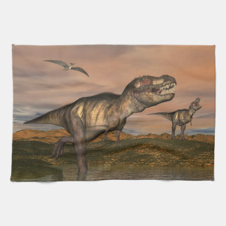 Two tyrannosaurus rex dinosaurs walking with ptera kitchen towel