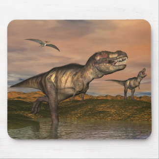 Two tyrannosaurus rex dinosaurs walking with ptera mouse pad