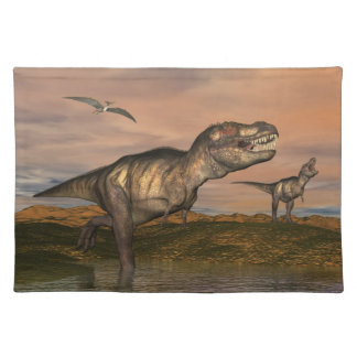 Two tyrannosaurus rex dinosaurs walking with ptera placemat