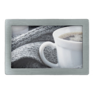 Two white cups of coffee wrapped in scarf belt buckle