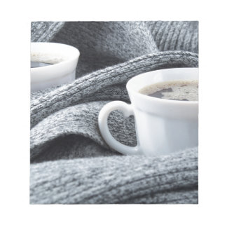 Two white cups of coffee wrapped in scarf notepad
