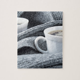 Two white cups of coffee wrapped in scarf puzzle