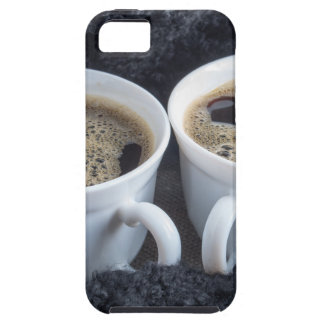Two white cups with black coffee and foam iPhone 5 covers