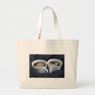 Two white cups with black coffee and foam large tote bag