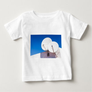 Two white satellite dishes on house wall baby T-Shirt
