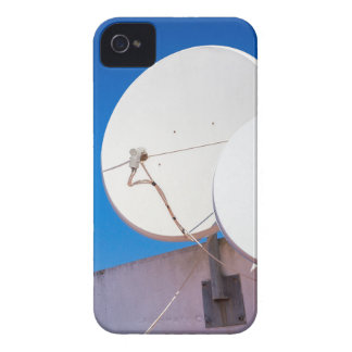 Two white satellite dishes on house wall iPhone 4 cover
