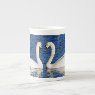 Two White Swans Form Heart Sign Tea Cup
