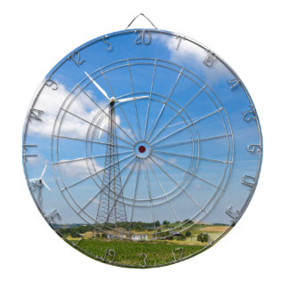 Two windmills in rural area with blue sky dartboard