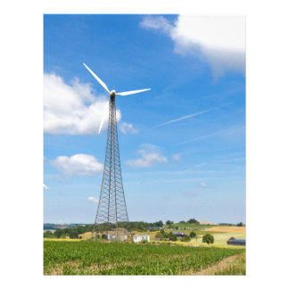 Two windmills in rural area with blue sky letterhead