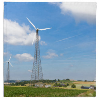 Two windmills in rural area with blue sky napkin
