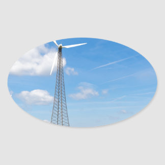 Two windmills in rural area with blue sky oval sticker