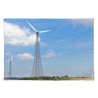 Two windmills in rural area with blue sky placemat