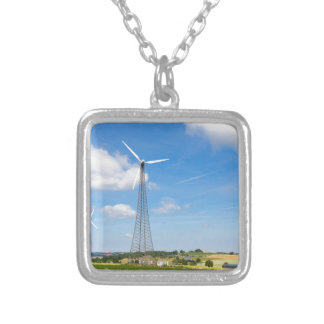 Two windmills in rural area with blue sky silver plated necklace
