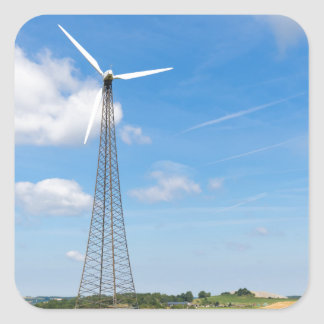Two windmills in rural area with blue sky square sticker