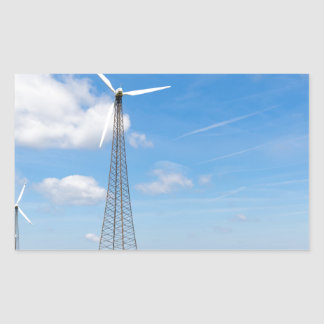 Two windmills in rural area with blue sky sticker